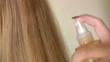 Woman applying hair lotion