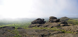 Beautiful misty mountain landscape, boulders, morning