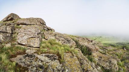 Beautiful misty mountain landscape, boulders, morning