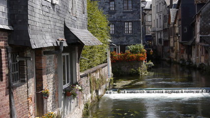 River in old street in Pont Audemer France