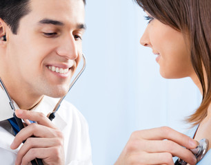 Doctor examing patient with stethoscope