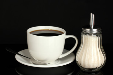 sugar bowl with cup of coffee isolated