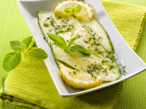 marinated zucchinis with lemon and mint leaves