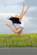 Ballerina leaping high in the air