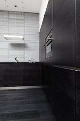 Part of black hardwood kitchen in modern style