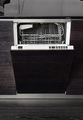 Open dish washer machine on black hardwood kitchen