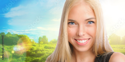 Young beautiful woman standing against idyllic landscape. Sunny
