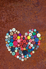 HEART FROM VINTAGE BUTTONS on the old rusty table