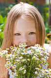 Little girl with a bunch of daisies