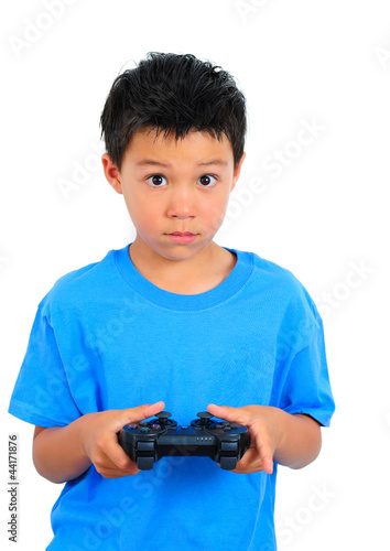 Boy in Blue T-Shirt Playing Game Holding a Controller