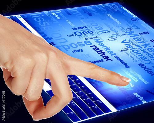 Finger touching a blue computer screen