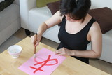 Japanese girl writing hiragana あ