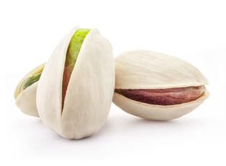 Pistachio nuts, isolated on white background, closeup
