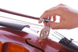 Hand that pulls the bow on the strings of a violin poster
