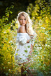 sensual young blonde female on field in sexy white short dress