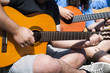 young people playing guitar together