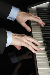 man hands playing piano