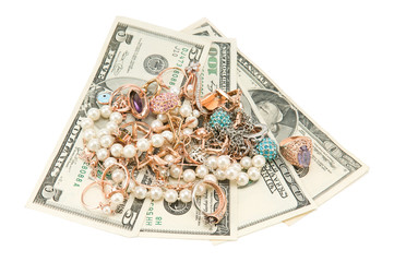 gold jewelry and dollars
