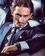 Beauty stylish guy in  car .