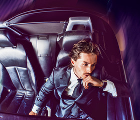 Beauty stylish guy in  car .