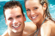 Young couple in jacuzzi.