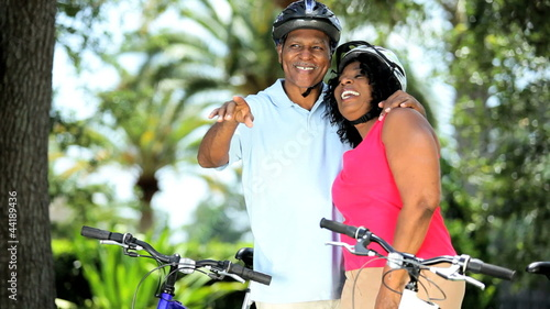 Senior African American couple enjoying cycling