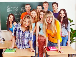 Group student near blackboard.