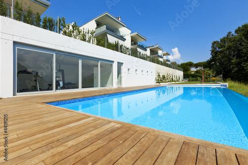 Leinwanddruck Bild residence with swimming pool