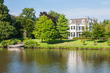 Large white villa on a waterside
