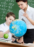 Geography teacher explains something to the pupil poster