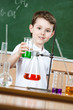 Little chemist shows colored liquid in conical flask