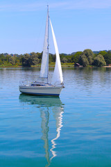The sail boat on the lake.