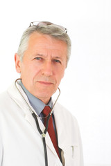 Vertical portrait of  matured, graying doctor