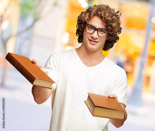 Portrait Of A Young Student Holding Books