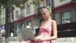 Attractive woman working on laptop in the city