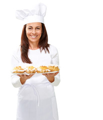Woman chef holding baked food