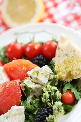fresh cheese salad with rocket and berrys