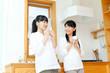 Beautiful young women relaxing in the kitchen. Portrait of asian