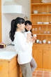 Beautiful young women relaxing in the kitchen. Portrait of asian