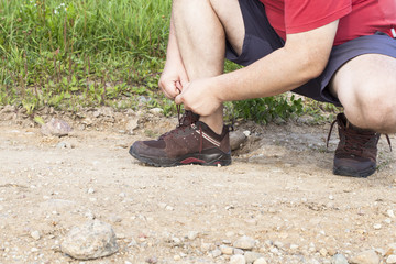 Man tied shoe laces on the trail
