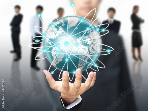 Businessman holding world network