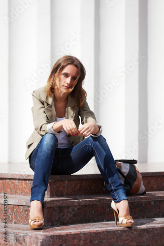 Young woman sitting on the steps