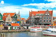 canvas print picture - Tourist boat in the port of Volendam. Netherlands