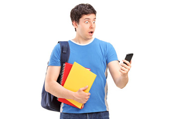 A surprised teenager looking at a mobile phone