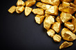 gold nuggets on a black background. closeup. - 44209613