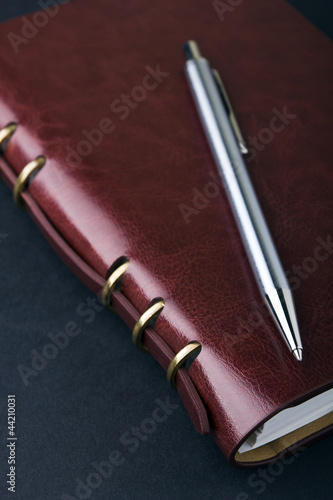 Notebook and pen in composition in black