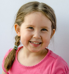 Portrait of pretty little girl smiling