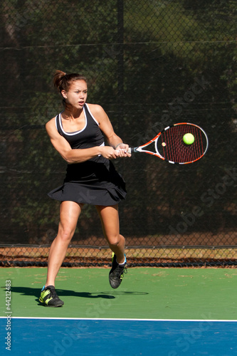 Female Tennis Player Hits Backhand