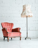 Armchair with desk lamp in vintage room