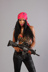 Sexy young woman with an assault rifle.